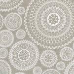 Tela loneta estampada motivos circulares en blanco fondo arena
