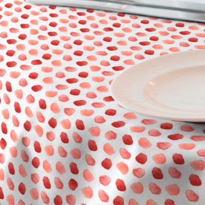 Loneta de huellas en color rojo y coral para mantel